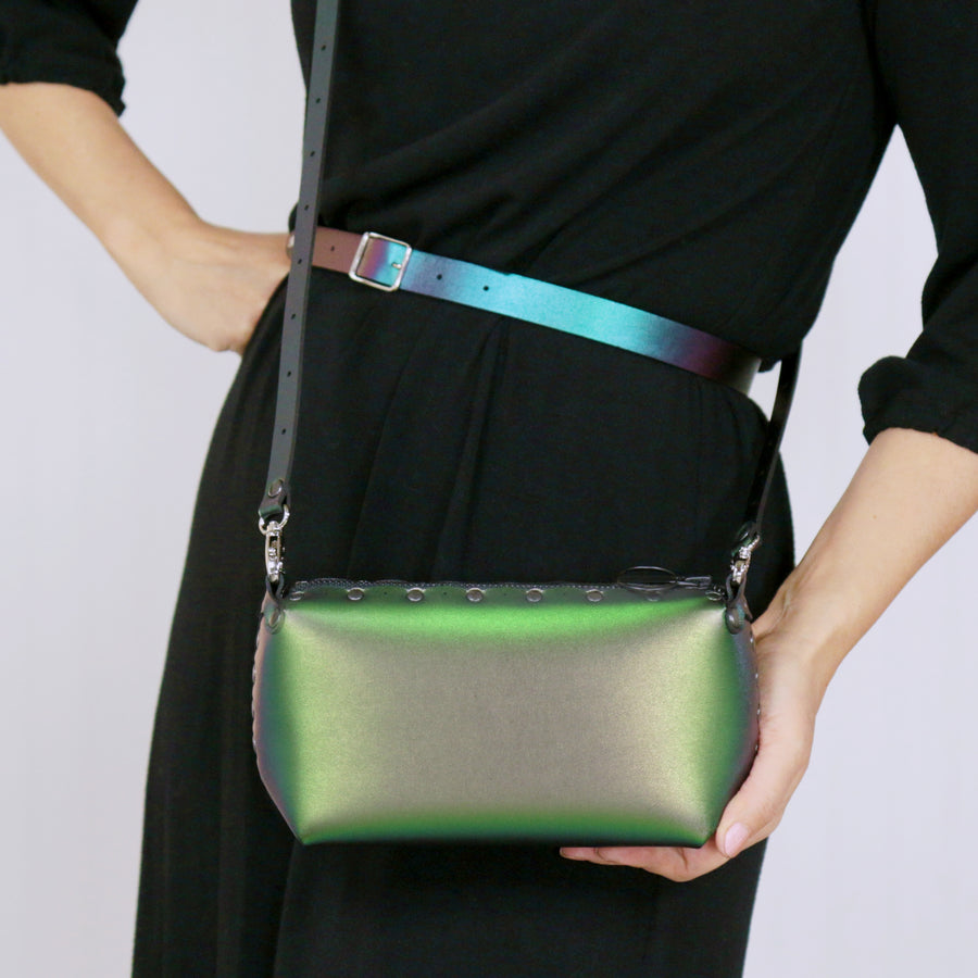 Model wearing emerald mini bag with crossbody strap