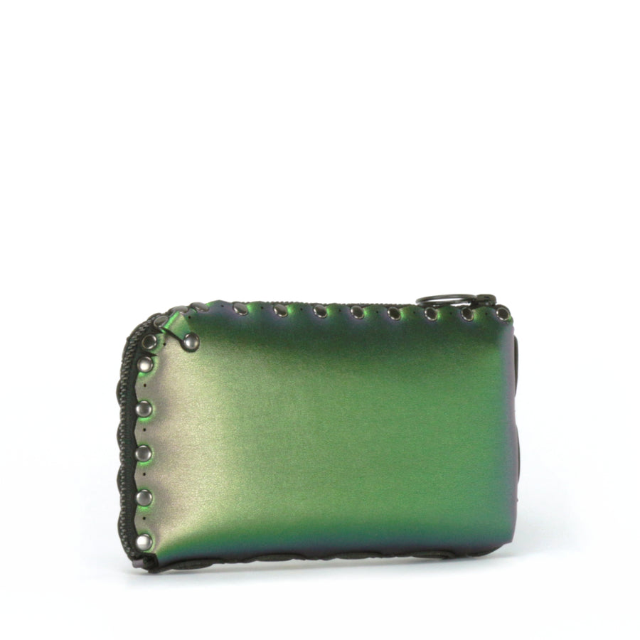 Side view of emerald wallet bag showing wrap around zipper