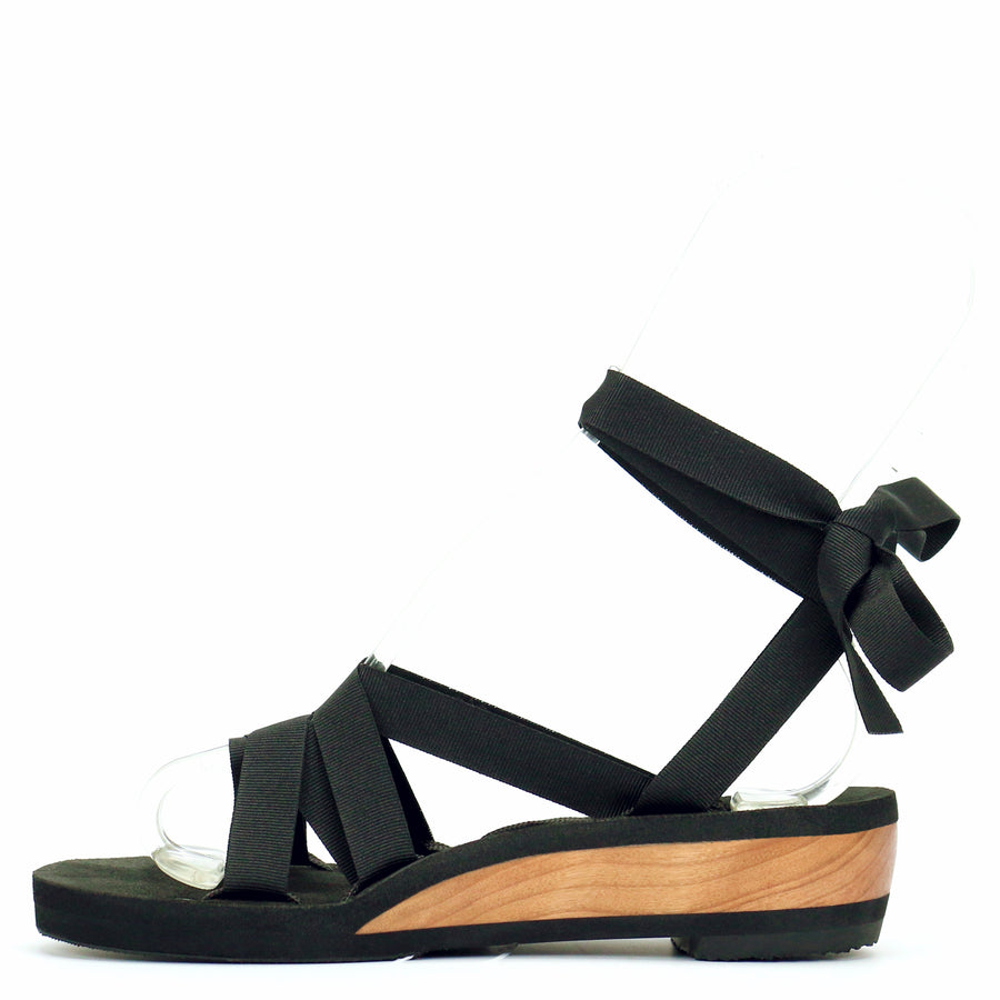 Low wedge slide ribbon sandals laced with black ribbon