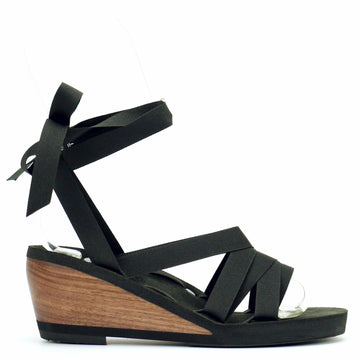 Mid wedge slide ribbon sandal laced with black ribbon