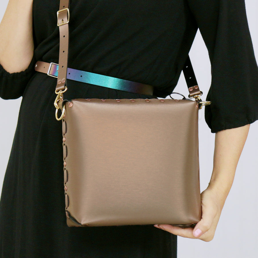 Model wearing a mocha medium crossbody bag