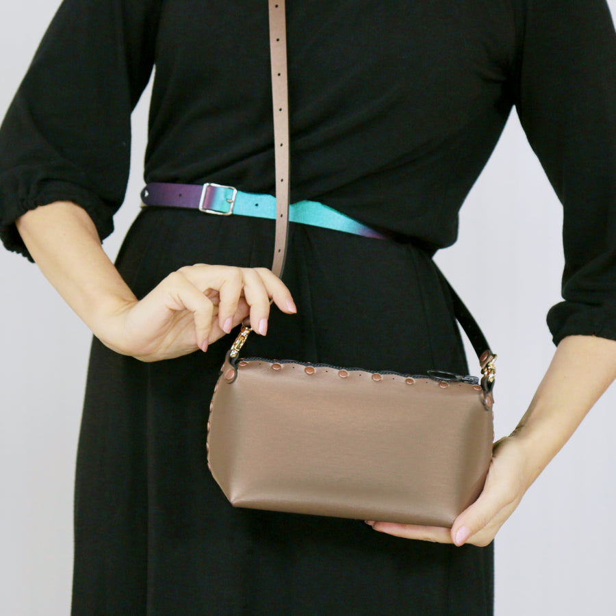Model wearing mocha mini bag with crossbody strap