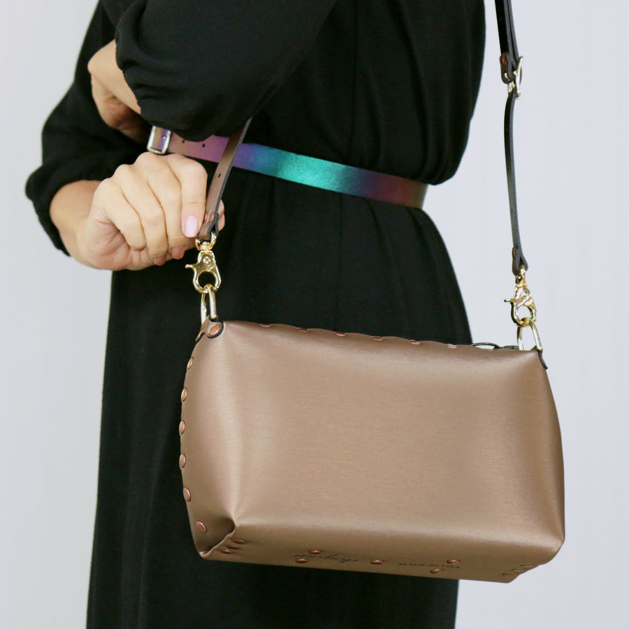 Model wearing a mocha small crossbody bag