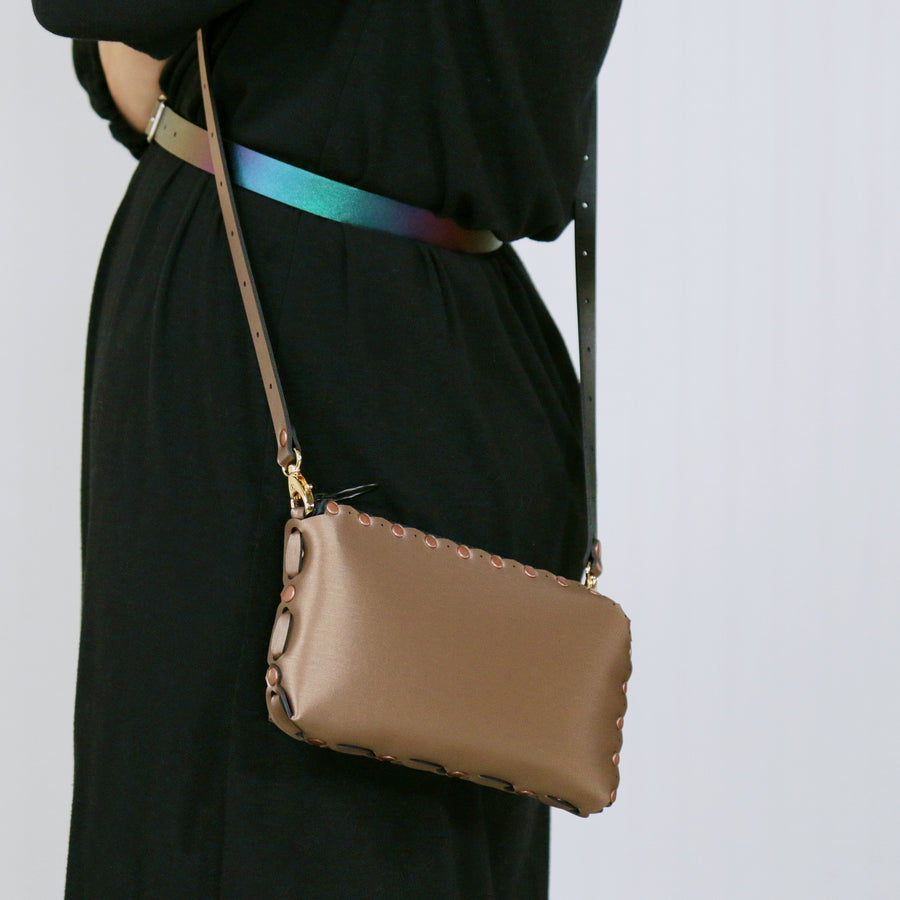 Model wearing mocha wallet bag