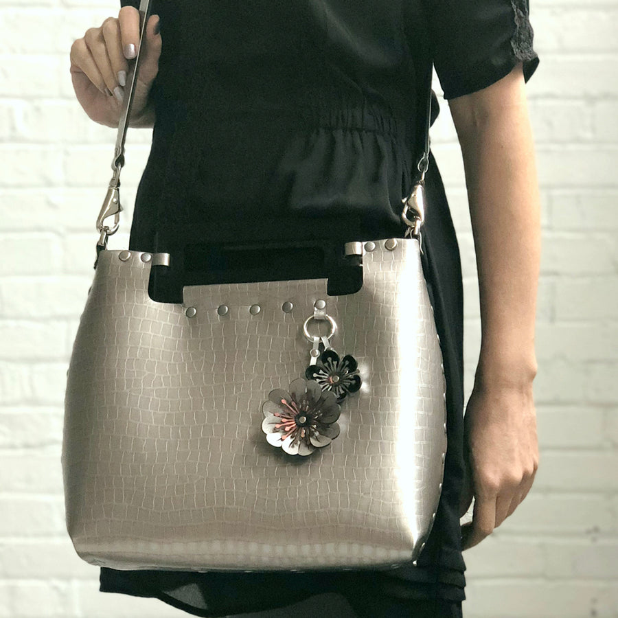 Silver Crocodile vegan leather medium crossbody bag with acrylic top handle and flower purse charm