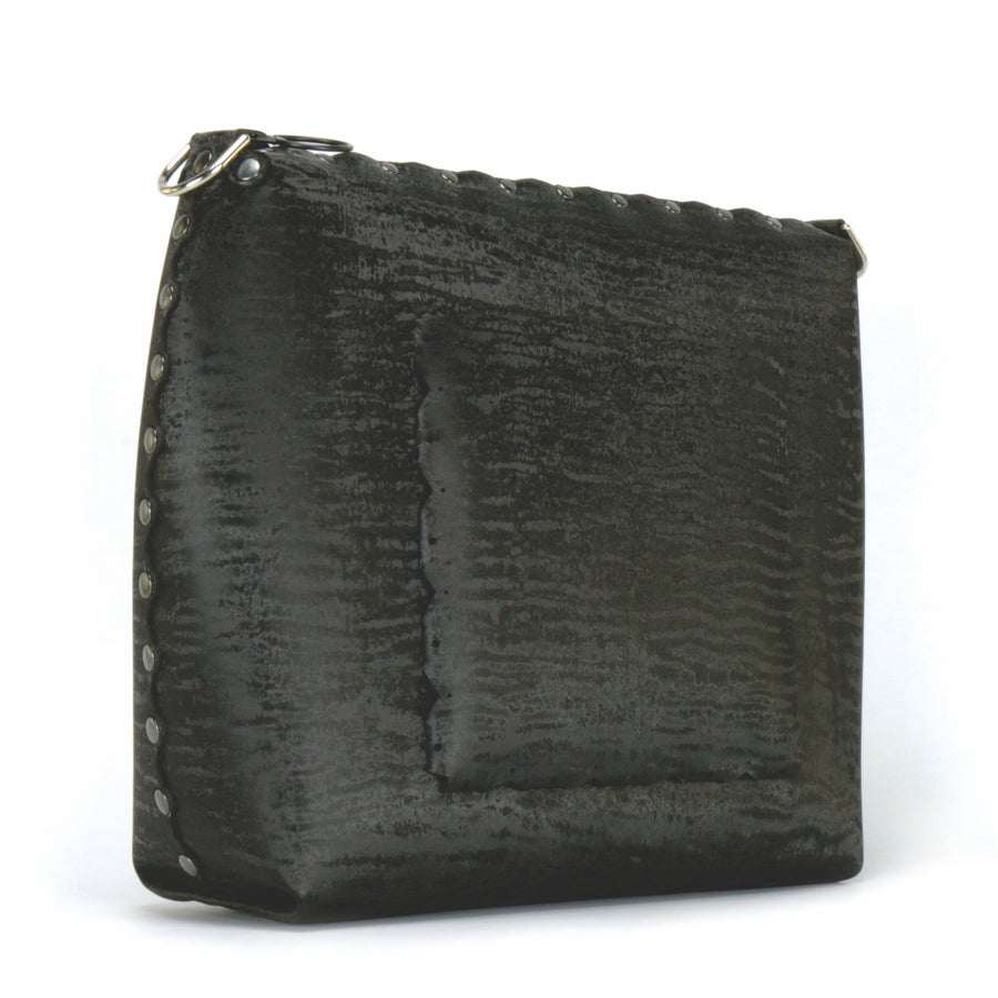 Rear side view of large onyx crossbody bag