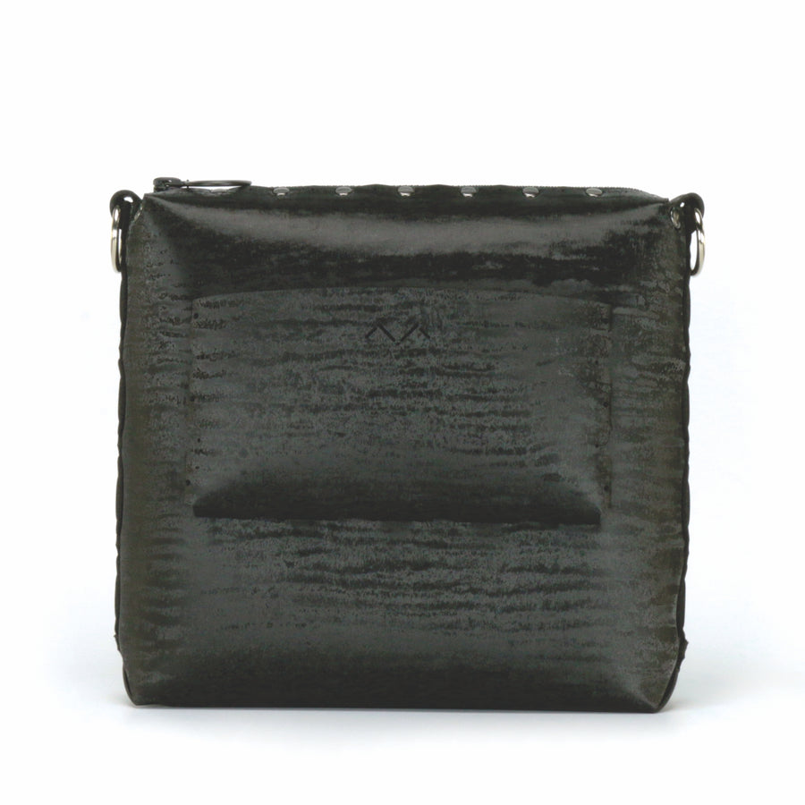 Rear view of onyx medium crossbody bag