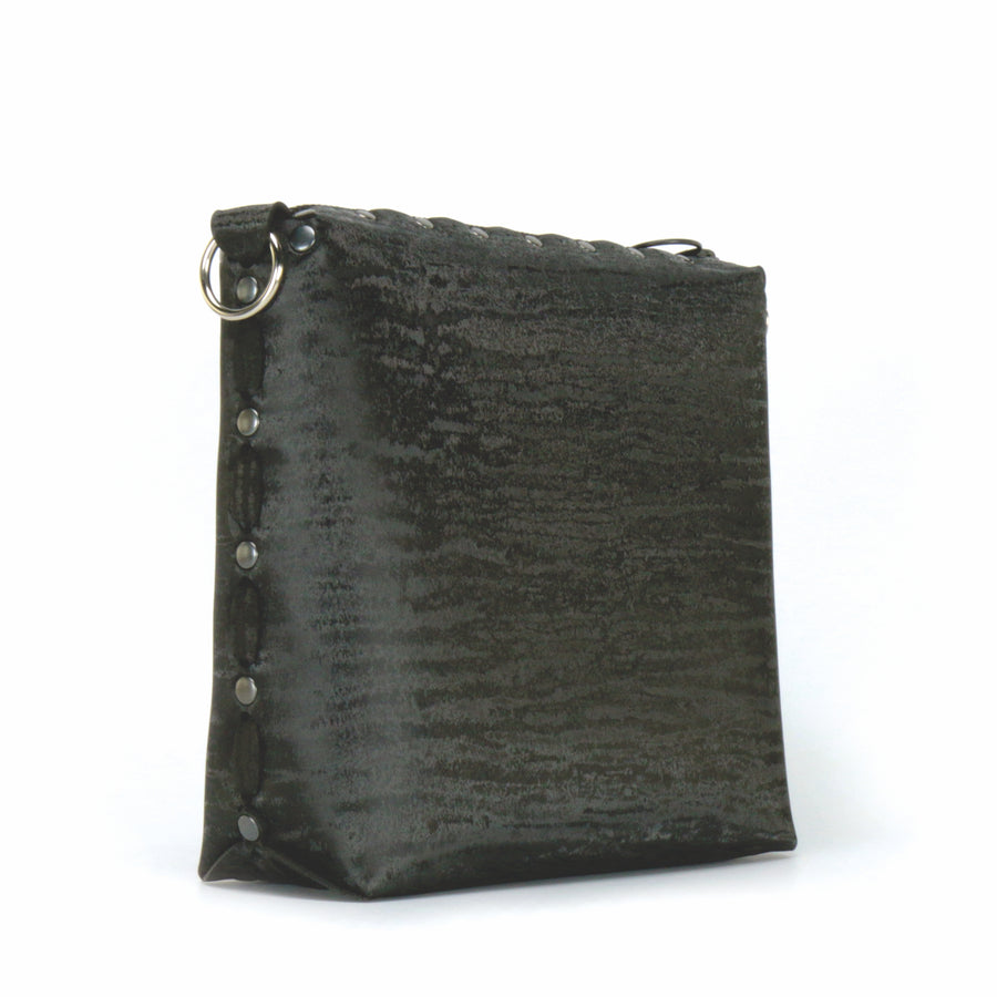 Front side view of onyx medium crossbody bag