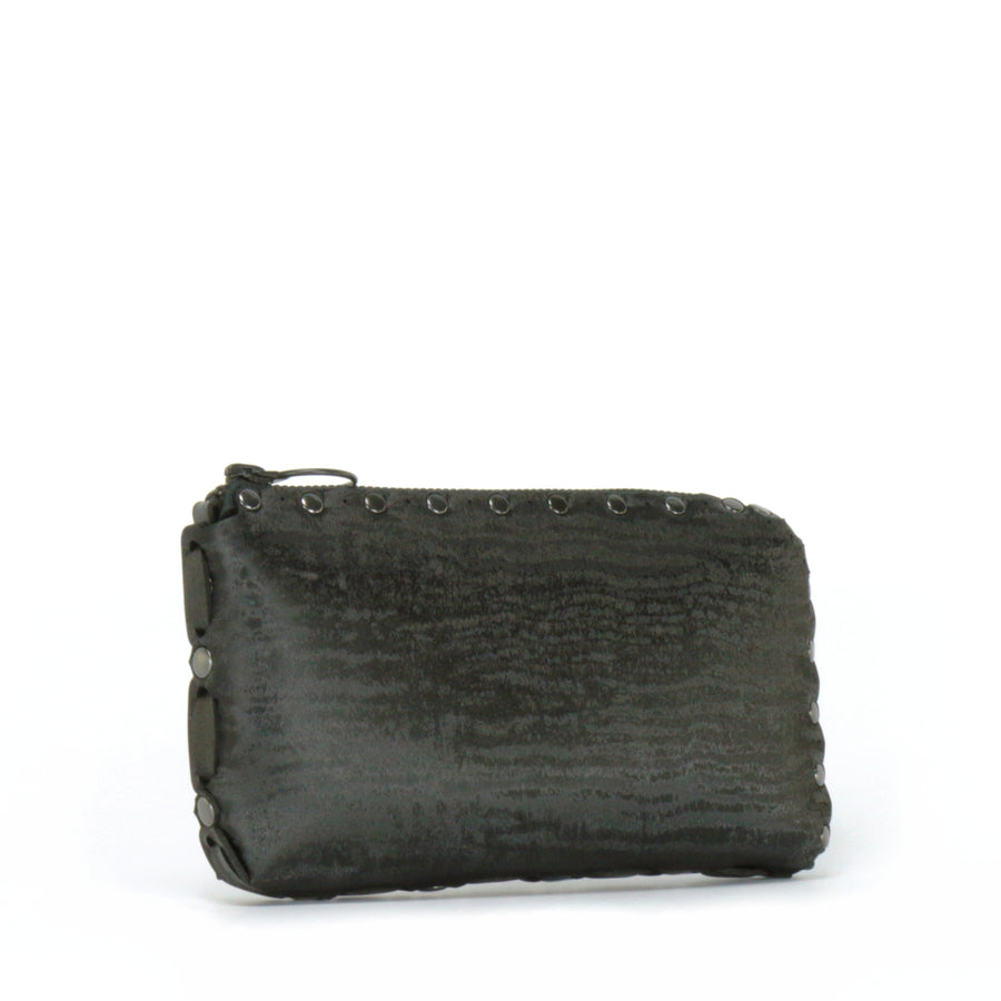 Side view of onyx wallet bag showing handwoven side seam