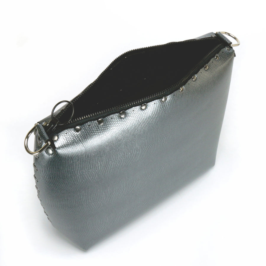 Top view of large pewter crossbody bag with zipper top