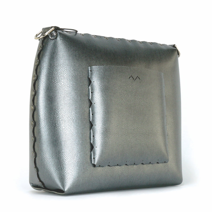 Rear side view of large pewter crossbody bag