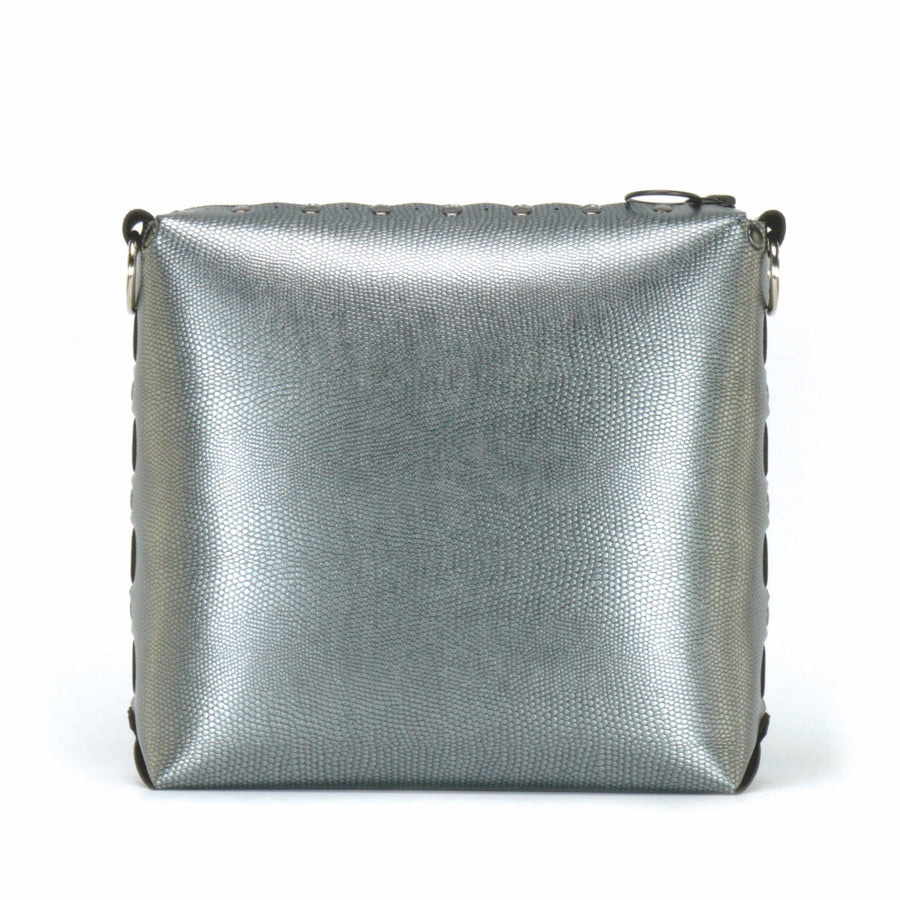 Front view of pewter medium crossbody bag without strap