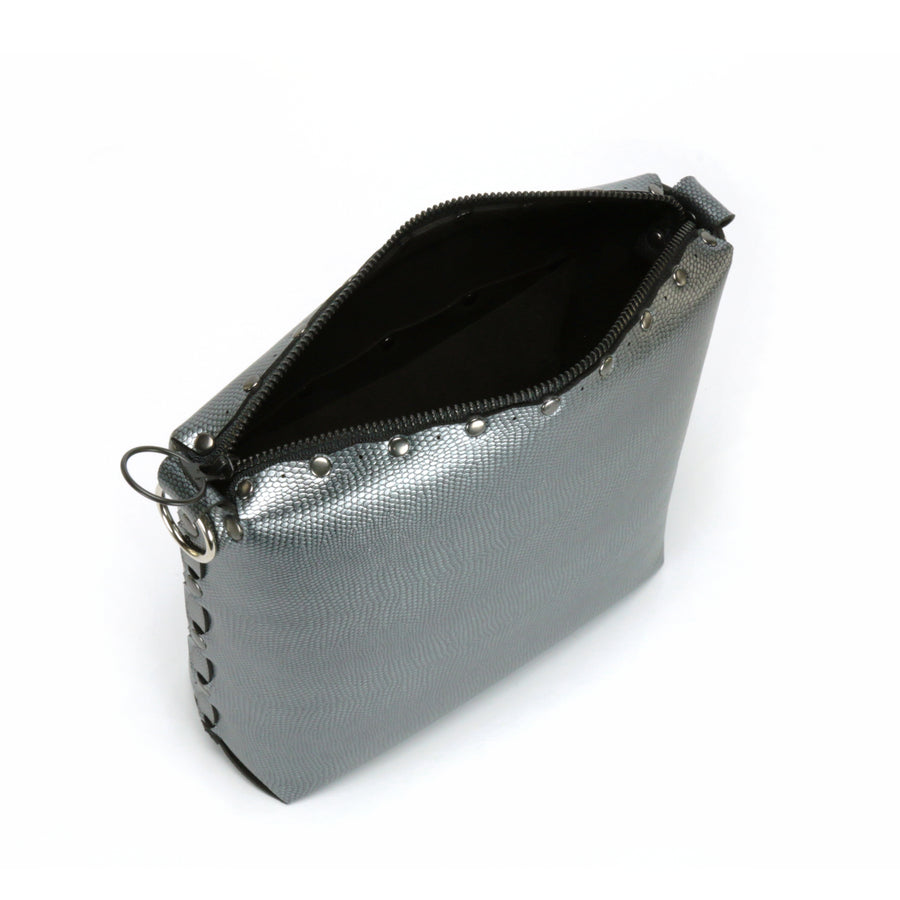 View of zippered top pewter medium crossbody bag
