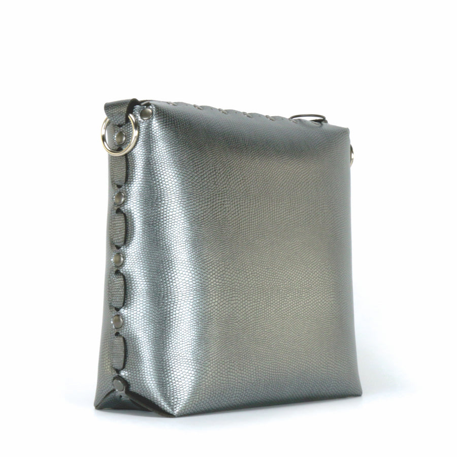 Side front view of pewter medium crossbody bag