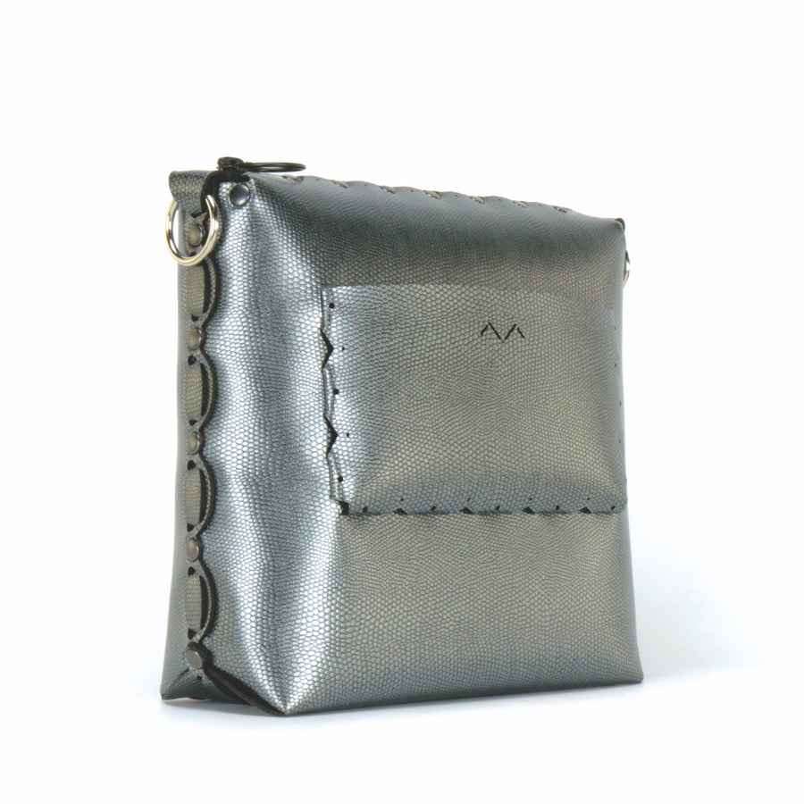 Rear side view of pewter medium crossbody bag