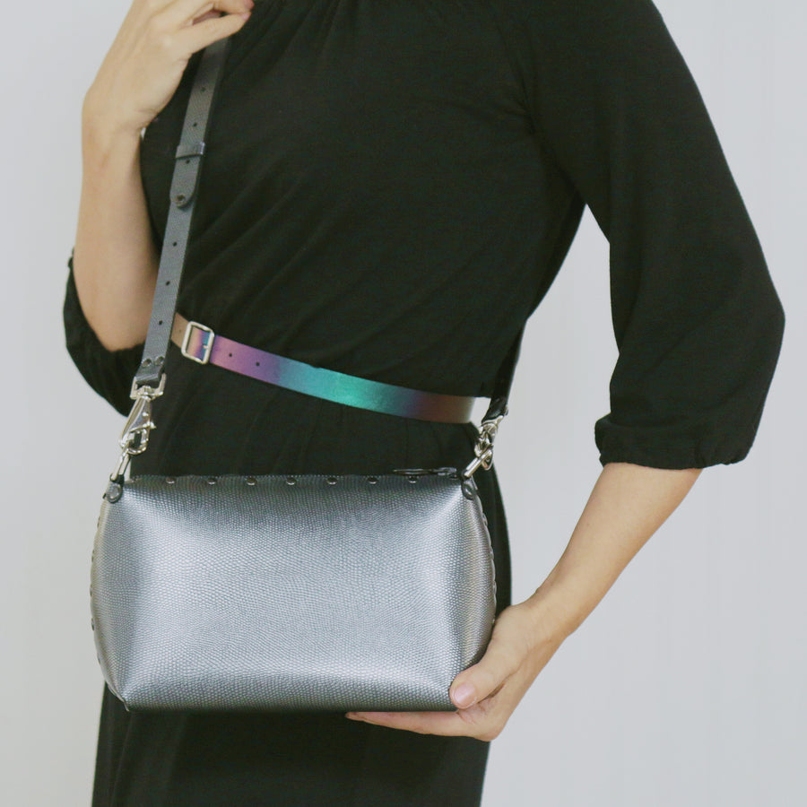 Model wearing a pewter small crossbody bag