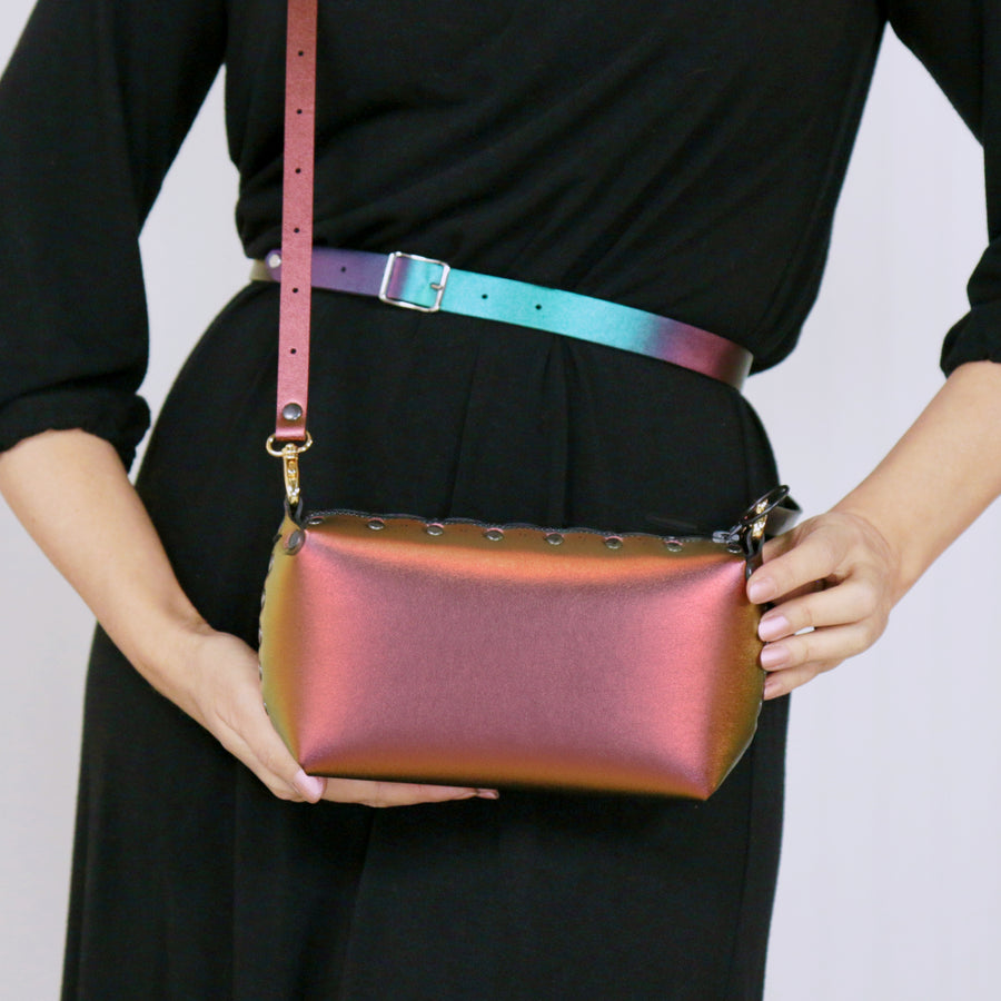 Model wearing ruby mini bag with crossbody strap