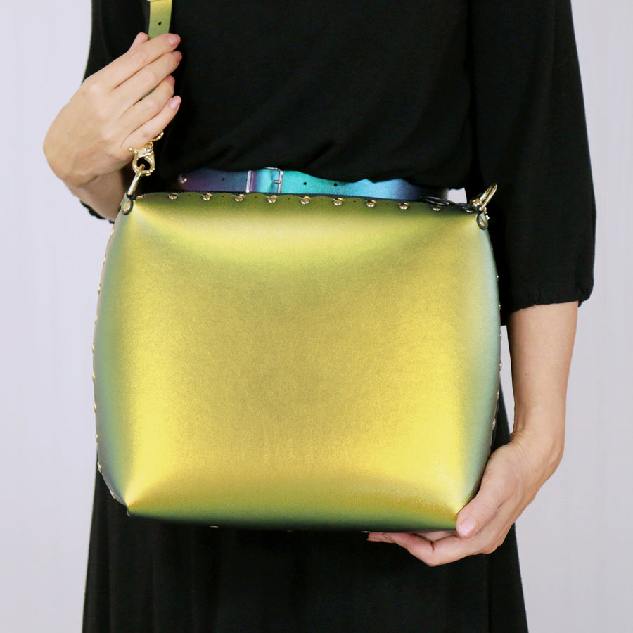 Model wearing large scarab crossbody bag
