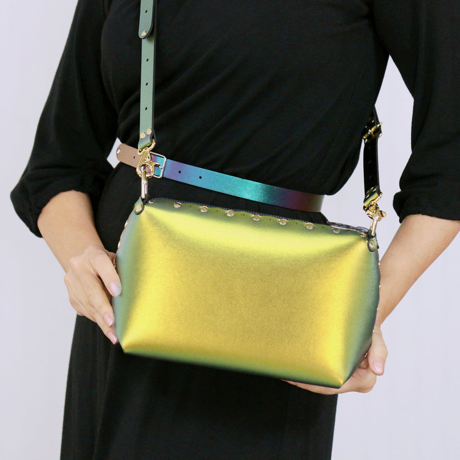 Model holding a scarab small crossbody bag