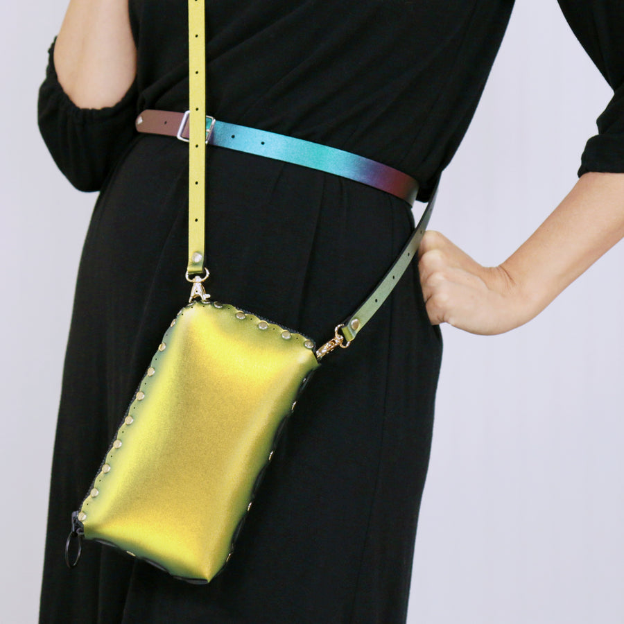 Model wearing scarab wallet bag with crossbody strap