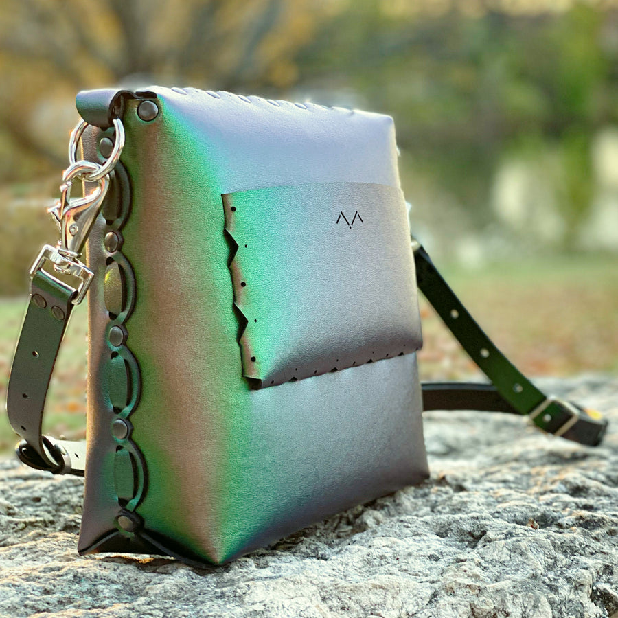 Emerald medium crossbody posed at park in autumn