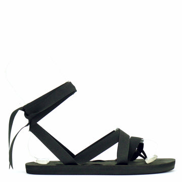 Flat ribbon sandal laced with black ribbon