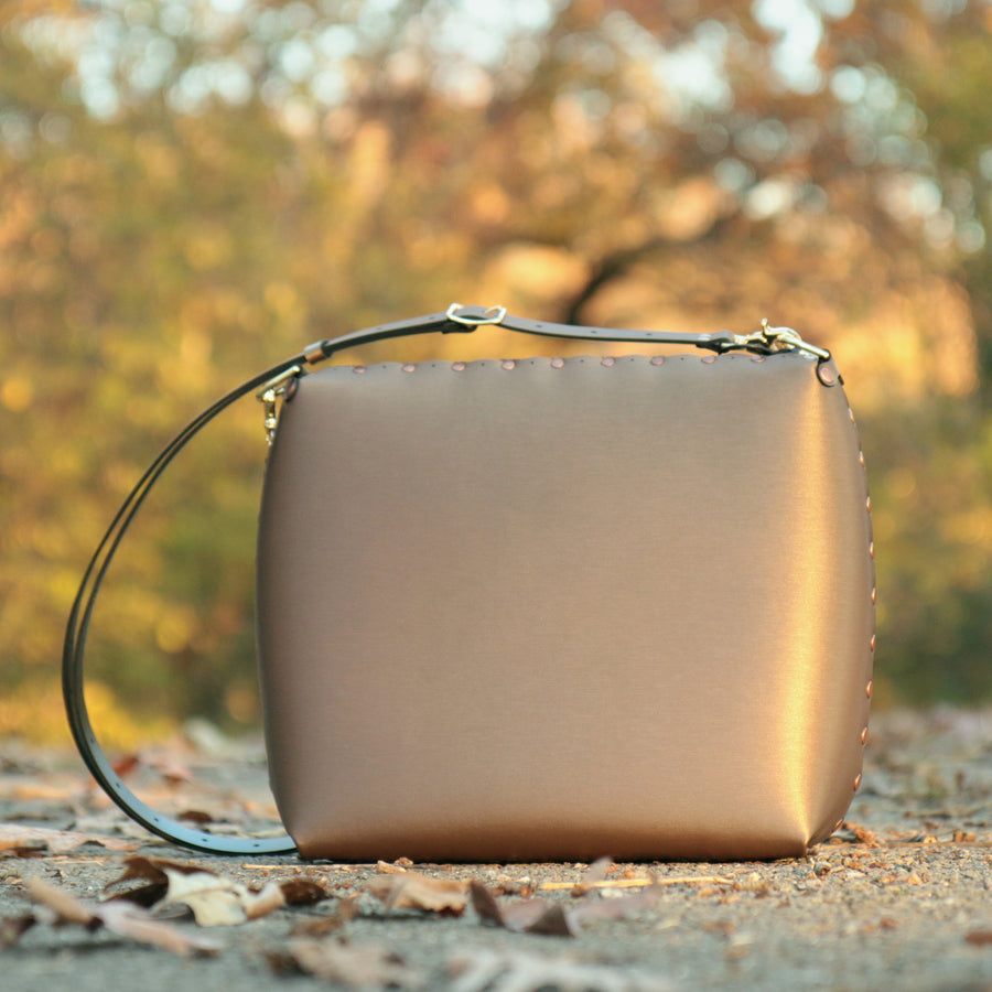 Large mocha crossbody bag viewed during autumn sunset