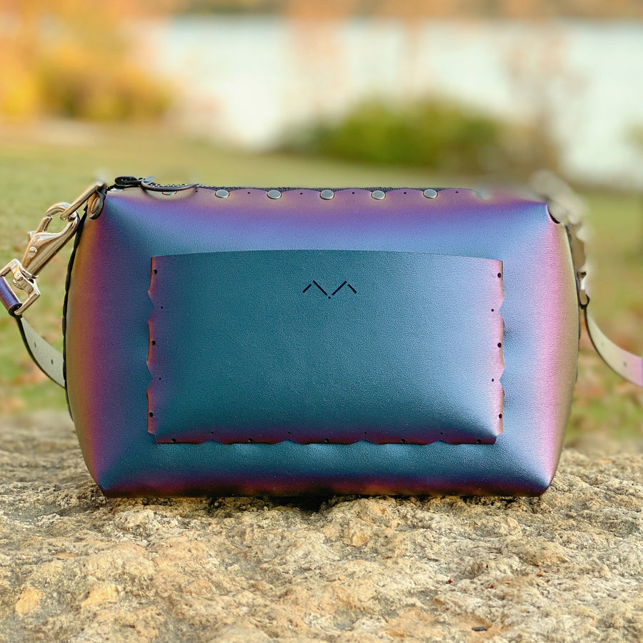 Peacock small crossbody bag shining brightly from autumn sunset