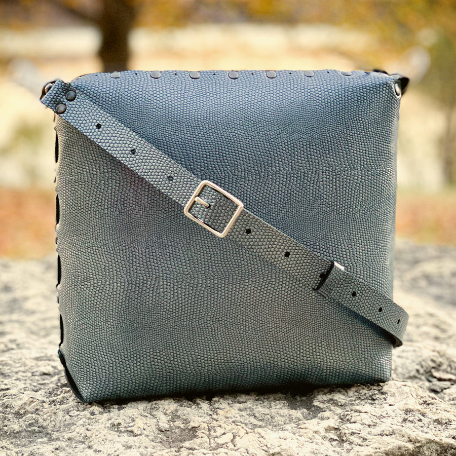Pewter medium crossbody bag with strap basking in the warm glow of early fall.
