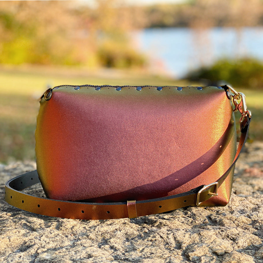 Ruby small crossbody bag with iridescent shine from setting autumn sun