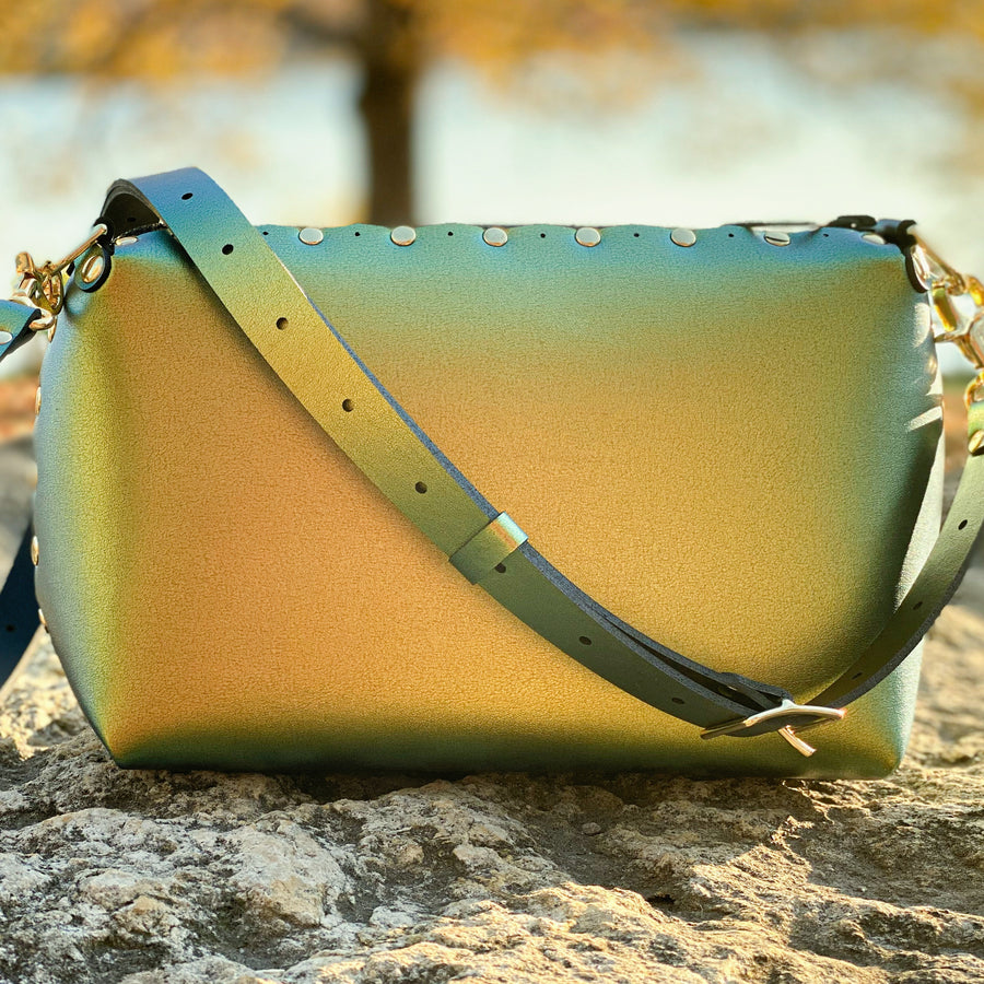 Scarab small crossbody bag with warm iridescent glow