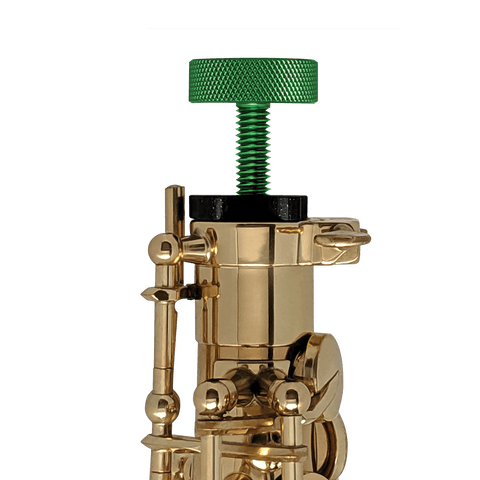 Green GapCap on an alto saxophone to protect the octave key and pads.