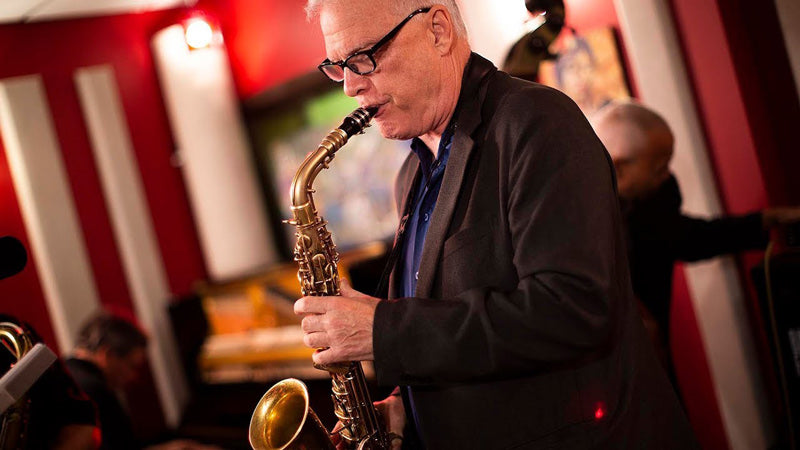 Jay Thomas playing alto saxophone