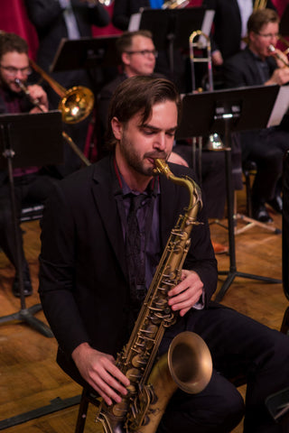 Saxophonist Lorenzo Ferrero playing tenor sax with a big band