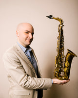 Rulon Brown holding an alto saxophone