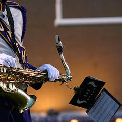 sax player with marching band uniform and lyre holder