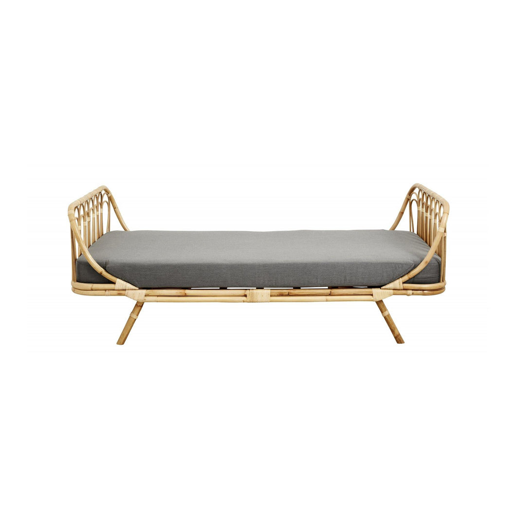 Rattan day bed w/grey fabric cushion