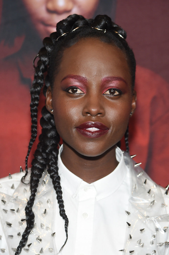 Lupita Nyong'o Wears Mini Titan Crystal Earrings