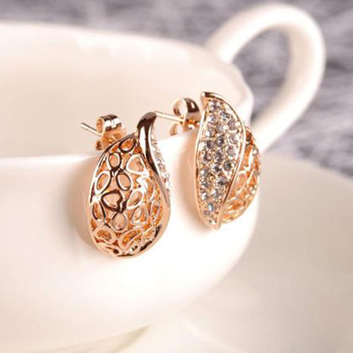 ELEGANT GEM-STUDDED GOLD LEAF STUD EARRINGS