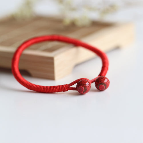 RED CERAMIC BEAD LUCKY STRING BRACELET [SET OF 2]