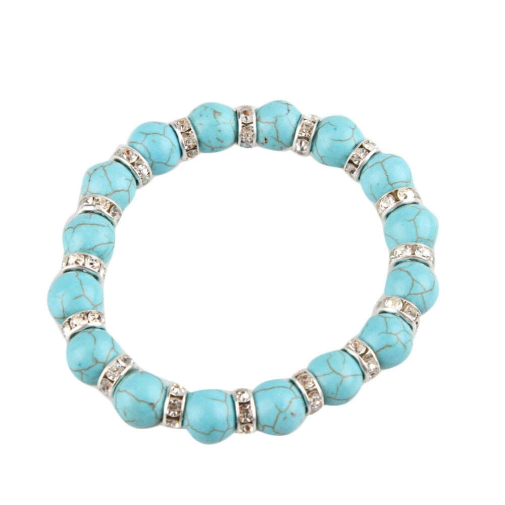 WOMEN'S ANTIQUE SILVER AND TEMPERED TURQUOISE BEADS CHARM BRACELET