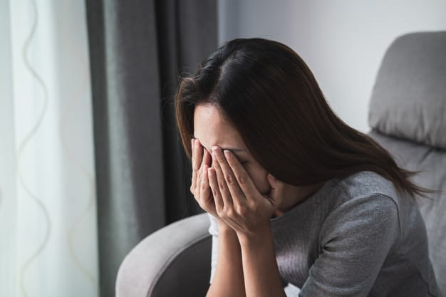 Depressed and sadness woman crying alone at home Premium Photo