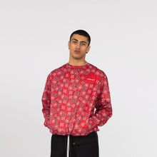 Load image into Gallery viewer, Model Editorial Image YOUNG WAR Paisley Crewneck Luxury Fashion Top Green with drawstrings Front View paired with Tux Pants