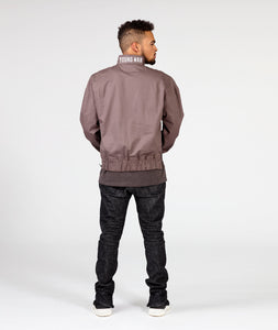 Male mode Mens wearing jeans and luxury fashion grey track jacket front view red lace and red slick lining back view