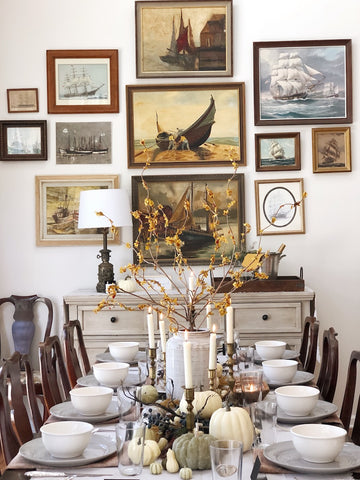 Thanksgiving tablescape inspired by vintage pieces and collected ship artwork