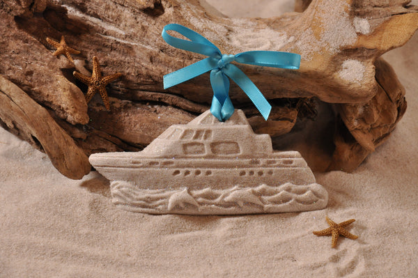 Yacht with Jumping Dolphins in the Waves Sand Ornament