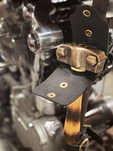 Nash X Mamoa Knucklehead Hammer mounted to motorcycle frame with black leather hammer hanger