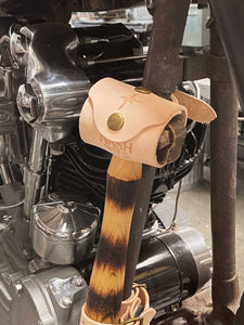 Nash X Mamoa Knucklehead Hammer mounted to motorcycle frame with natural leather hammer hanger