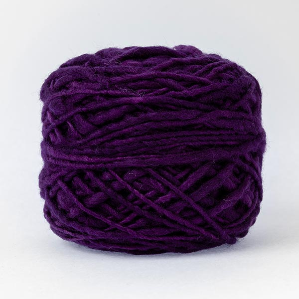 100% merino wool deep purple colour ball of yarn