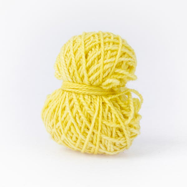Small yellow duckling balls of wool